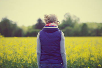 Girl in field from behind