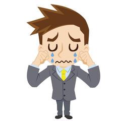 泣く若いビジネスマン