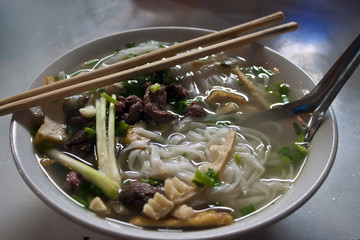 Bowl of Vietnamese soup, in street restaurant in Sapa, Vietnam