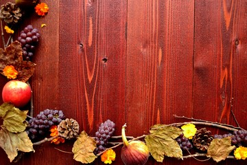 Autumn fruits,fall leaves and yellow cosmoses