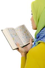Woman In Hijab Reading Koran