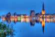 City port of Rostock by night - 68483622