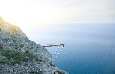 Cliff Into Blue Water