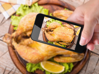 Hands taking photo  chicken with smartphone
