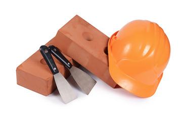 Building brick with a helmet