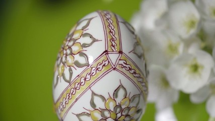 Easter wax painted egg and plum cherry flowers close-up