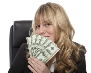 Smirking businesswoman with a fistful of dollars