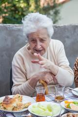 senior woman telling something