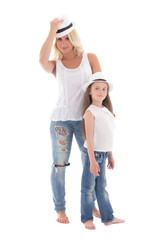 beautiful young mother and little daughter posing with hats isol