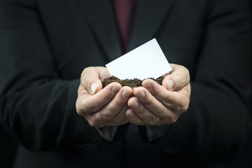 Business card in hands on the ground