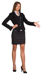 Businesswoman points hand toward