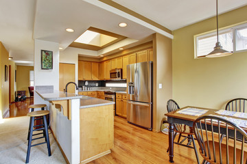 Kitchen room with skylight and dining area