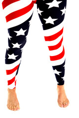 Womens legs in stars and stripes leggings bare feet