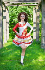 Young woman in irish dance dress dancing outdoor