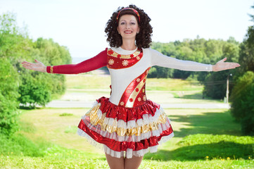 Young woman in irish dance dress welcoming outdoor