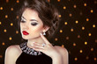 Beautiful brunette woman model with makeup and hairstyle in fash