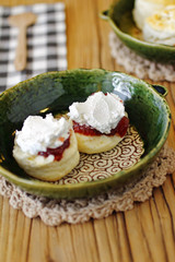 close up japanese scones and fruit jam in ceramic dish