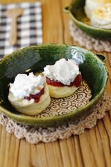 close up japanese scones and fruit jam in ceramic dish