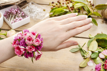 Steps of making wrist corsage. Florist at work.
