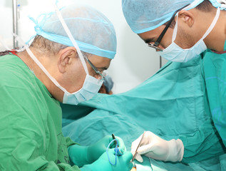 Surgeons working on a patient in operation room