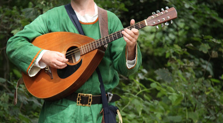 A Musician Playing a Classic Medieval Mandolin.