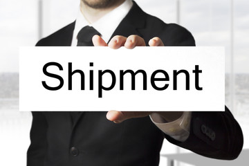 businessman holding sign shipment
