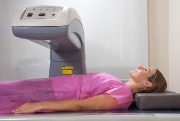 Happy woman undergoing open MRI scan