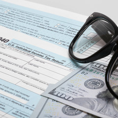 USA 1040 Tax Form with glasses and dollars - 1 to 1 ratio