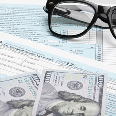 1040 Tax Form, glasses, calculator and dollars - 1 to 1 ratio
