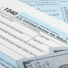 US Tax Form 1040 with 100 US dollar bills - 1 to 1 ratio