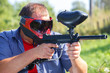 Strong man with paintball gun