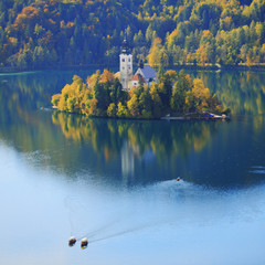 two boats and island on Bled lake in Slovenia