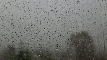 Rain splashing on the window pane
