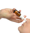 Woman using medicine nose spray nasal isolated
