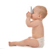 Happy child baby toddler sitting smiling kissing mobile cellphon