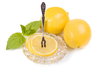 Lemons - slices and fruit on crystal saucer, vintage Fork for le