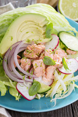 Salad with poached salmon and vegetables