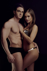 Hot Couple Posing on Underwear Looking at Camera