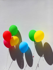 Colorful festive balloons on wall