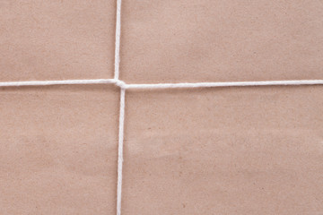 Background of white cardboard paper tied with twine