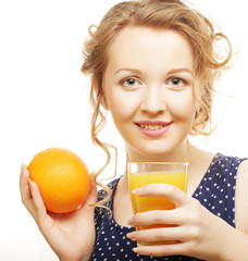 Woman holding orange and  juice over white