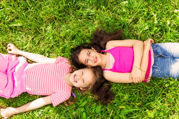 View from above of two beautiful girls on grass