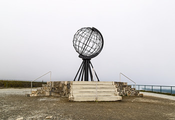 Symbolic globe in cloudy day at the North Cape/ Nordkapp, Norway