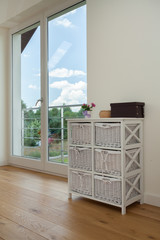 Commode in a room with balcony