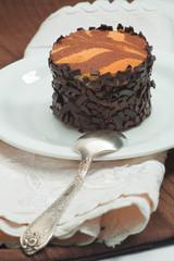 Cocoa cream desert with dark chocolate flakes