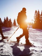 snow shoe walking sillhouette