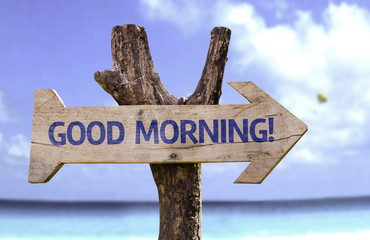 Good Morning! wooden sign with a beach on background