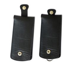 black leather keychains isolated on white background