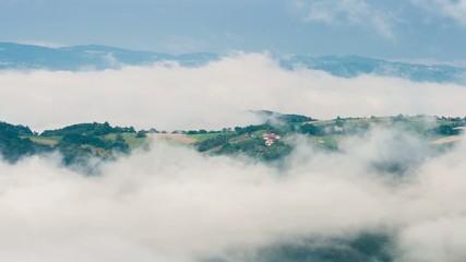 Clouds surrounding a farm area