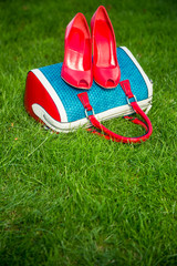 Women's shoes are on the bag and on the ground